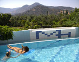 Our pool, with an amazing view to the green mountains